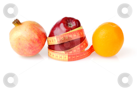 Fruit diet for weight lost stock photo, Red fresh apple wrapped up by tape with pomegranate and orange by Iryna Rasko