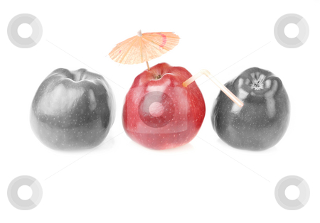 One red apples and two colourless apples stock photo, Two colourless red apples and one apple with cocktail tube and umbrella by Iryna Rasko
