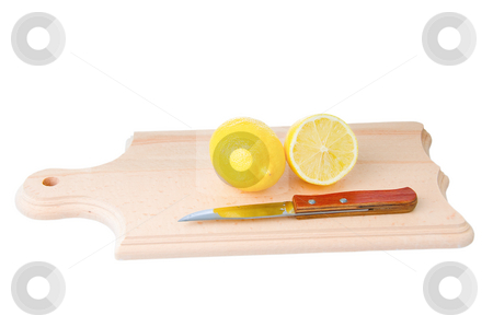 Cutted lemon and knife on wooden plank stock photo, One whole lemon and one cutted lemon with knife on wooden plank. Isolated on white background. by Iryna Rasko