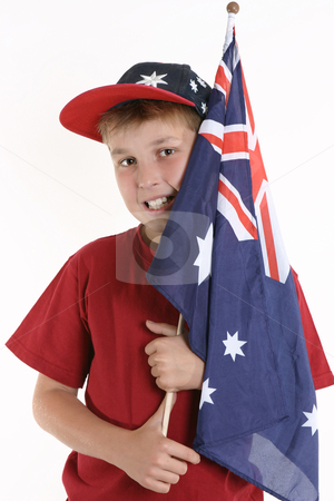 True Blue - Patriotic boy holding australian flag stock photo, A young boy casually holds an Australian flag by Leah-Anne Thompson