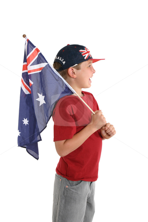 Aussie boy holding a flag. stock photo, An Australian boy holding a flad and facing sideways. by Leah-Anne Thompson