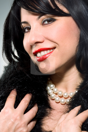 Pretty woman with a pearly Smile stock photo, Smiling Brunette with a beautiful pearl necklace by Leah-Anne Thompson