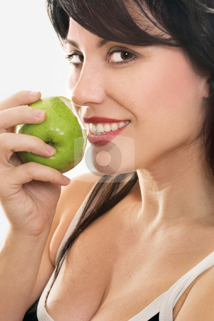 Forbidden Fruit - woman eating apple stock photo, A beautiful smiling woman eating a fresh green apple.  eg - health, diet, nutrition, sin, temptation, etc... by Leah-Anne Thompson