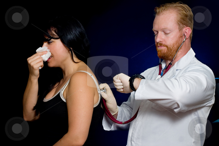Health Check stock photo, A patient receives a checkup.  Focus on hands and stethoscope by Leah-Anne Thompson