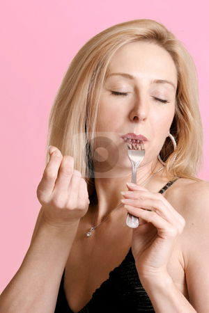 Bellisimo taste sensational stock photo, Woman eating with a fork and gesturing bellisimo by Leah-Anne Thompson