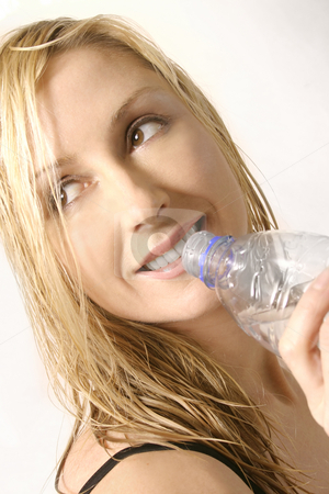Hydrate - woman with water bottle stock photo, Happy woman with water bottle by Leah-Anne Thompson