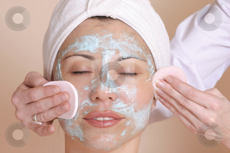 Beauty treatment - cleansing skin stock photo, Beautician cleansing the skin of a female customer. by Leah-Anne Thompson