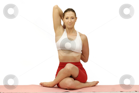 GOMUKHASANA stock photo, Woman performing Gomukhasana on a mat. by Leah-Anne Thompson