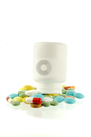 Bottle with falling out pills stock photo, Bottle with falling out many-coloured pills by Iryna Rasko