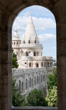 Budapest castle towers through round-headed window stock photo, Fairytale looking Budda castle towers through  round-headed window of a tower by Iryna Rasko