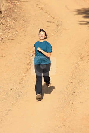 Girl runner stock photo, A young girl running outdoors enjoying the movement by ARPAD RADOCZY