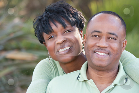 Attractive Happy African American Couple stock photo, Attractive and Affectionate African American Couple posing in the park. by Andy Dean