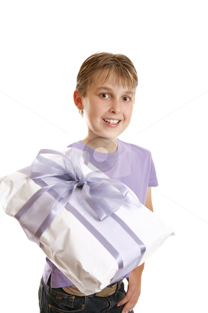 A boy holding a wrapped present stock photo, A boy holds a wrapped present tied up with gauze and satin purple ribbon. by Leah-Anne Thompson