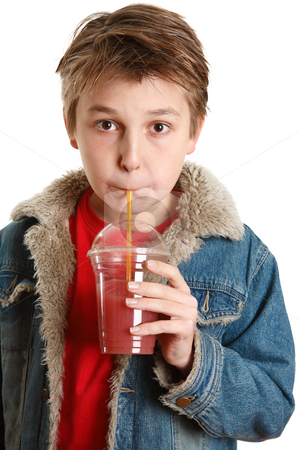 Child drinking fresh fruit juice through a straw stock photo, A young boy drinking fresh mixed berry health juice in a clear cup container with a yellow straw.  He is wearing a red t-shirt and a blue denim jacket. by Leah-Anne Thompson