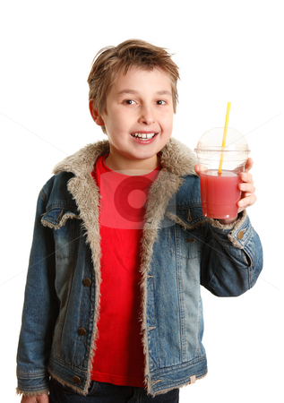 Happy healthy boy holding fresh fruit juice in clear cup stock photo, A happy young boy holding a freshly made juice in a clear disposable cup.   He is smiling cheerfully. by Leah-Anne Thompson