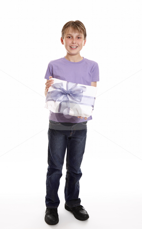 Boy with a mother's day or birthday present stock photo, A boy smiles with a wrapped present tied up with big ribbon bow by Leah-Anne Thompson