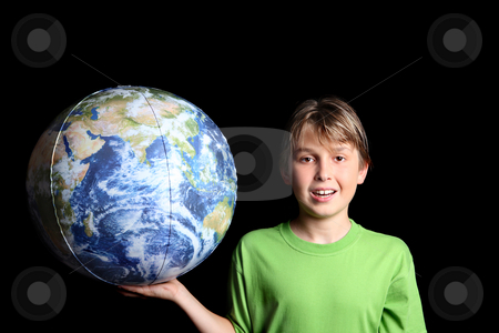 Boy holding the world earth ball in his hand stock photo, A young boy holding the earth world ball in his hand against a black background.  Images from Nasa. by Leah-Anne Thompson