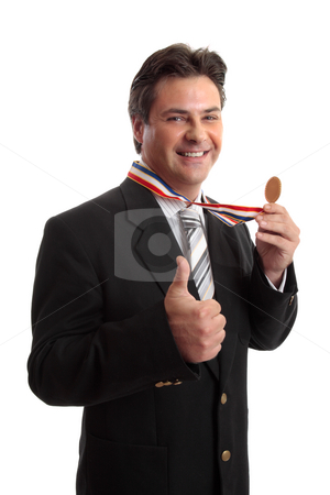 Business or personal success stock photo, Businessman with awarded medal.   Business, personal, sporting success  or other recognition by Leah-Anne Thompson