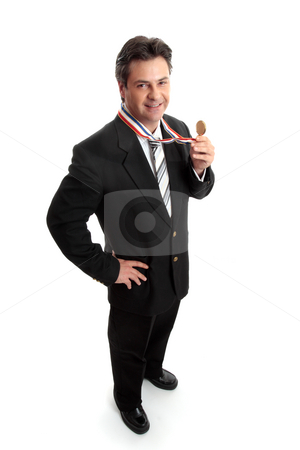 Small Business or Salesman of the Year stock photo, Businessman celebrates success with the first place award for his business. by Leah-Anne Thompson