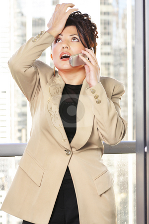 Oh No stock photo, Businesswoman makes a gestuer while on the phone. -- eg: annoyed, frustrated, forgetful, mistake by Leah-Anne Thompson