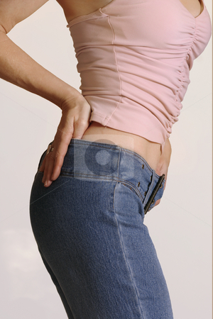 Get in Shape stock photo, Get in shape, Shapely girl in jeans side view by Leah-Anne Thompson