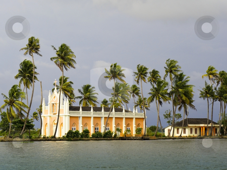 Church by the river stock photo, A beautiful keralan church with exotic palm trees at the side of a river by Mike Smith