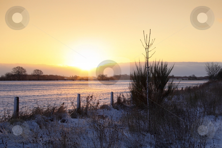 Colorful evening stock photo, Sun going down over snowy fields in winter by Mike Smith