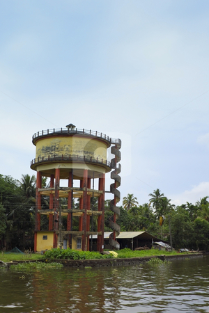 Water supply tank stock photo, A water supply tank near a river in the keralan backwaters south india by Mike Smith