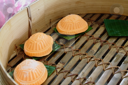 Ang-ku Cakes stock photo, A Chinese gelatinous rice cake. Inside each cake is filled with sweet bean paste and the cakes are steamed in a bamboo tray. by Ah Hock Ong