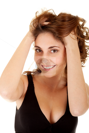 Smiling woman in a black dress stock photo, Beautiful smiling woman in a black dress with hands in her hair on white background by Iryna Rasko