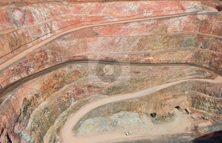 Deep mine hole in rock strata stock photo, Very deep mine with layers in the rock strata by Phil Morley