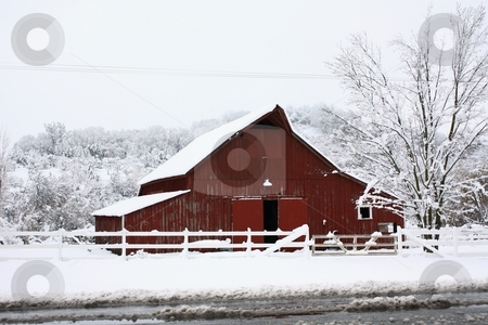 Big red barn in the snow. stock photo, Big red barn in the snow by Gregory Dean