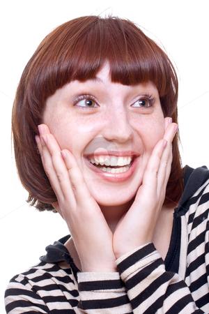 Laughing girl in a T-shirt stock photo, Laughing girl in a T-shirt on a white background by Artem Zamula
