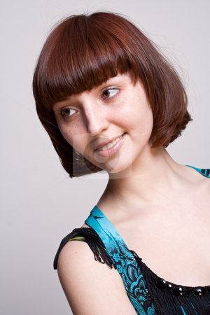 Laughing girl in a dress stock photo, Laughing girl in a dress on a gray background by Artem Zamula