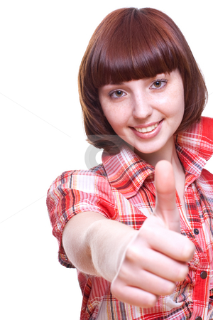 Laughing girl in a shirt giving thumbs-up stock photo, Laughing girl in a shirt giving thumbs-up on a white background by Artem Zamula