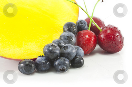 Mango and berries stock photo, Mango, Blackberries and Cherries on white by Chris Alleaume