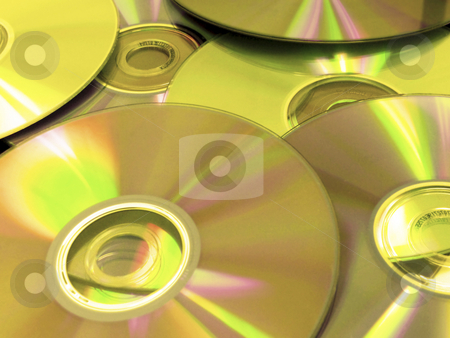 Optical discs stock photo, Golden optical discs - cd, dvd, blu-ray, hddvd by Mile Atanasov