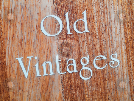 Old vintages stock photo, Old vintages in white letter written on wood panel by Laurent Dambies