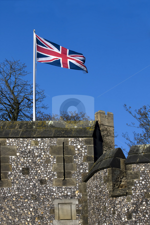 British battlement stock photo, British flag flying over a castle battlement in England by Darren Pattterson
