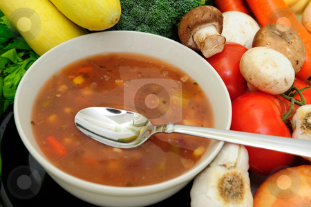 Vegetable Soup stock photo, Bowl of veggie soup with a spoon surrouned by assorted fresh vegetables by Lynn Bendickson