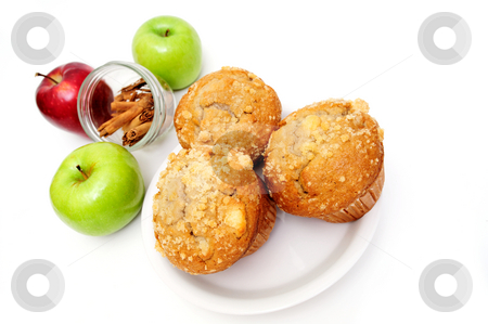 Muffins On A Saucer stock photo, Apple spice muffin with red and green apples and stick cinnamon in the background isolated on white by Lynn Bendickson