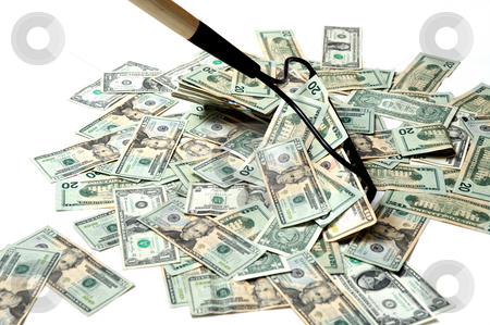 Raking In The Cash stock photo, United States twenty dollar bills insolated on a white background being raked up with a garden rake to show the concept of making money easy by Lynn Bendickson