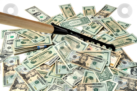 Raking In The Money stock photo, United States twenty dollar bills insolated on a white background being raked up with a garden rake to show the concept of making money easy by Lynn Bendickson