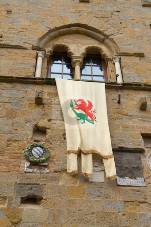 Stadtwappen am Rathaus von Volterra - City flag at the townhall  stock photo, Stadtwappen am Rathaus von Volterra - City flag at the townhall of volterra, tuscany by Wolfgang Heidasch