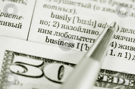 Business stock photo, Fifty dollars and the pen on the dictionary by Salauyou Yury