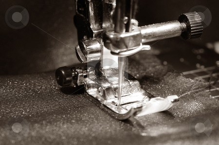 Sewing machine stock photo, To sew a  material on the sewing machine by Salauyou Yury