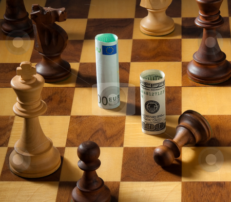Currency on Chessboard stock photo, Euro and Dollar on a chessboard. Square format. by Erwin Johann Wodicka