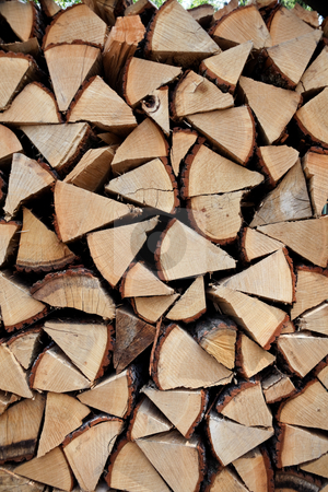 Stacked Firewood stock photo, Stack of split firewood. Vertically framed shot. by Erwin Johann Wodicka