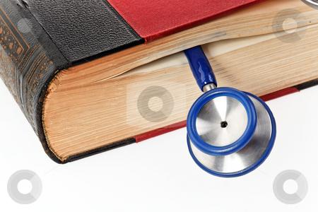 Stethoscope in Book stock photo, Stethoscope in book. Horizontally framed shot. by Erwin Johann Wodicka