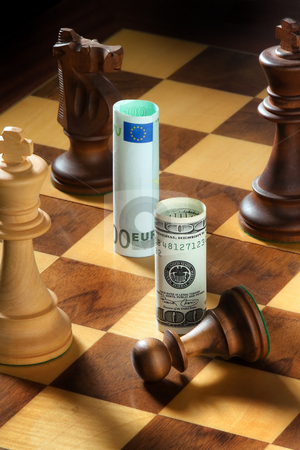 Currency on Chessboard stock photo, Euro and dollar on a chessboard. Vertically framed shot. by Erwin Johann Wodicka